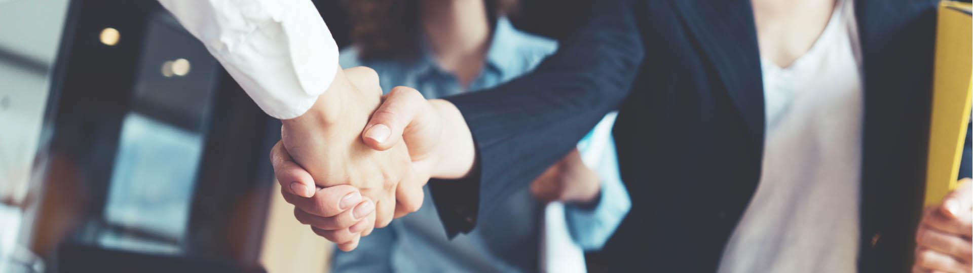 Implico-Partner-Program-Handshake